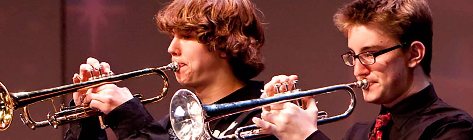 Young performers playing trumpets