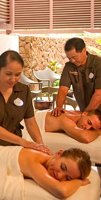 A man and woman receive a couples massage at Laniwai Spa at Aulani