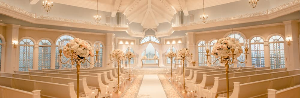 Disneys wedding pavilion florida weddings escape collection sunlight shines through the arched stained glass windows of a wedding chapel with chandeliers and a junglespirit