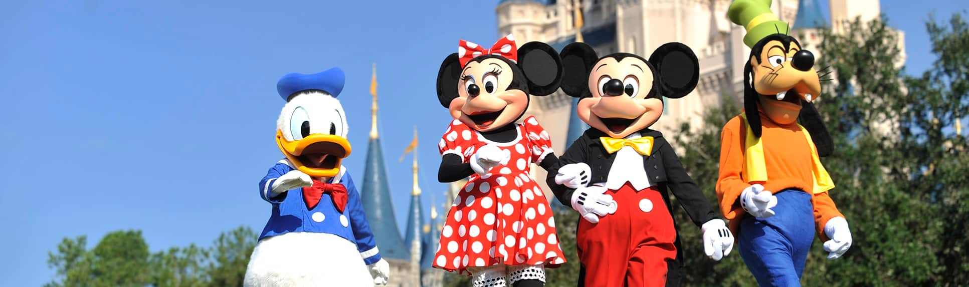 Characters Donald Duck, Minnie Mouse, Mickey Mouse and Goody near Cinderella Castle at Magic Kingdom park