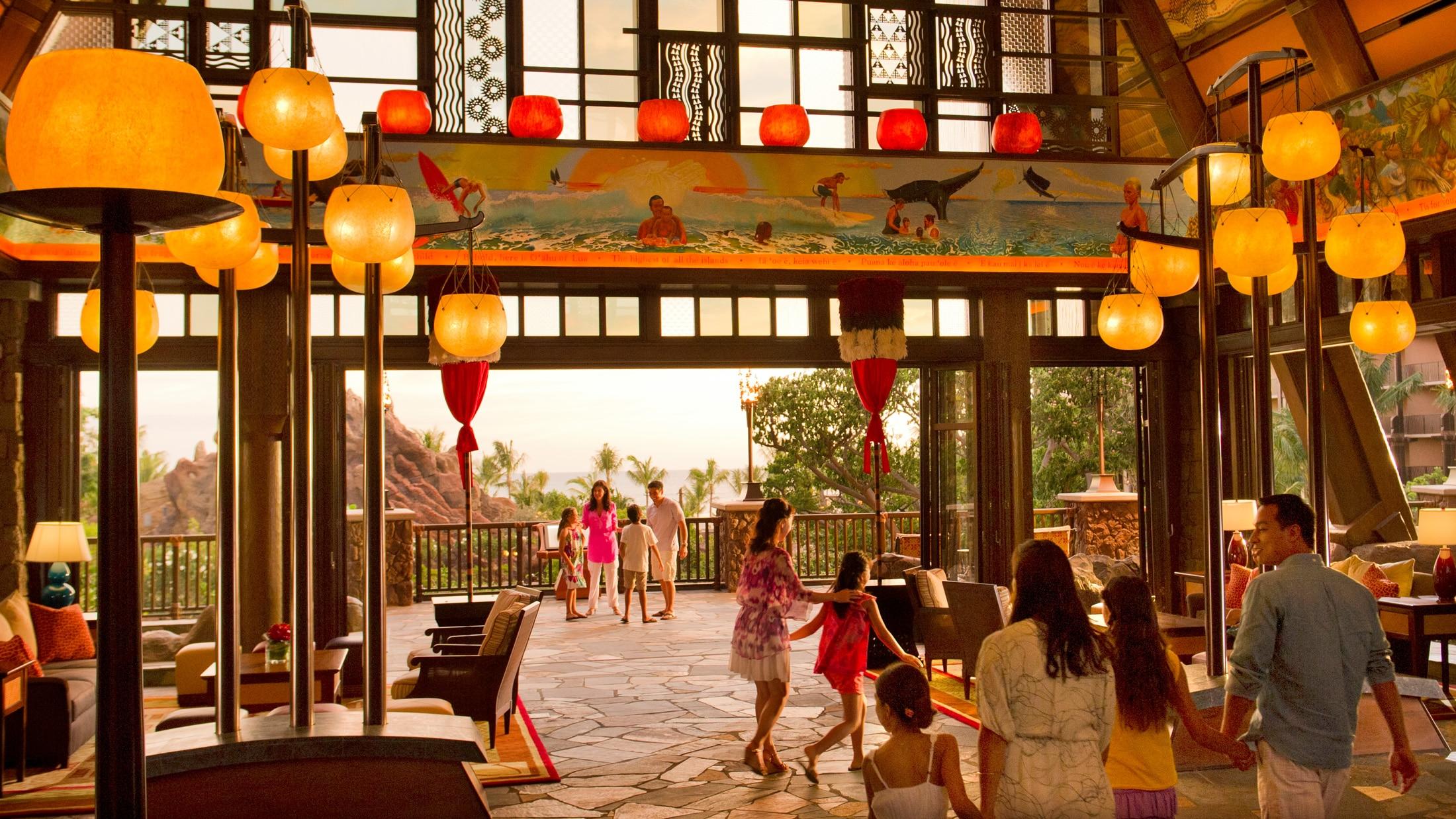 Guests walking through the lobby at Aulani Resort