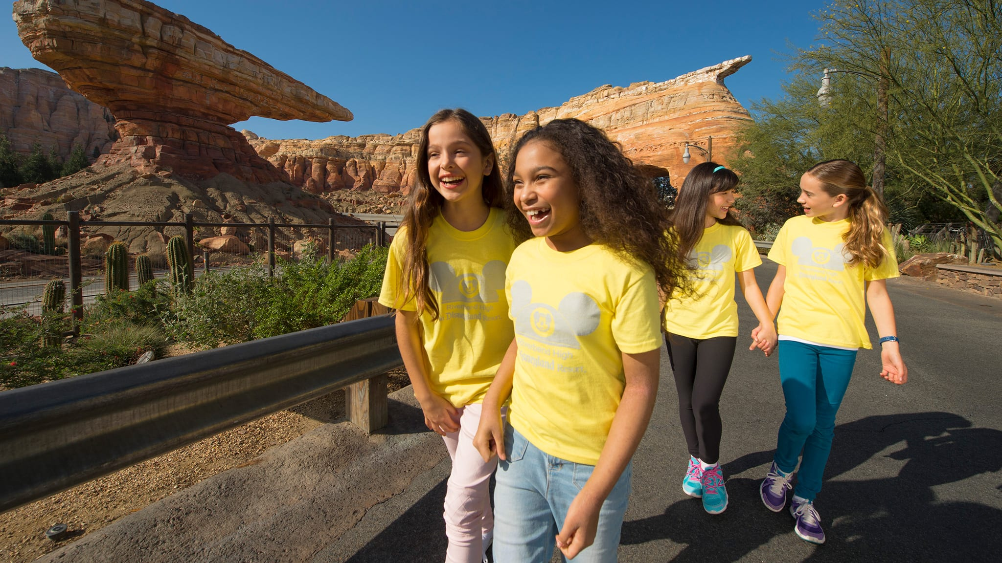 Young girls smiling and walking in Disney California Adventure Park